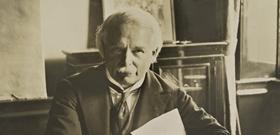 Lloyd George sitting at desk